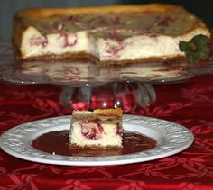This Strawberry Swirl Cheesecake Recipe is baked in a 9 inch spring form pan. I chose to use a square spring form for a different presentation. Serve with strawberry sauce.