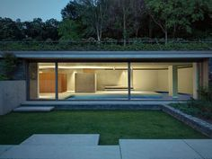 """This modern pool house by ACT ROMEGIALLI is an """"extension"""" if you will to an existing 1900 liberty building. The clients requested that the pool house Swimming Pool Images, Indoor Swimming Pools, Underground Swimming Pool, Modern Pool House, Pavillion, Moderne Pools, Journal Du Design, Villa, Building A Pool"""
