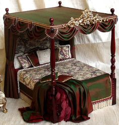 Silk handmade miniature 1/12th scale dollshouse swags and tails curtains, dressed beds, silk canopies, dressing tables and stools, lamberquins, bedspreads and pillow in victoria, art deco and tudor styles.
