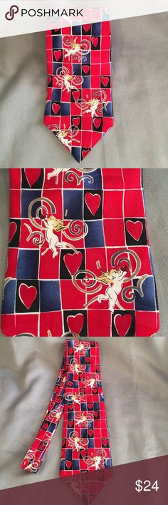 Hallmark Seasonal Concepts Cherub and Heart Tie Hallmark Seasonal Concepts Cherub and Heart Tie. It is mainly blue and red tie with cherubs and hearts. Great for Valentines. Gently used. Measures approx 56.5 inches long and approx 4 inches at its widest. Hallmark Accessories Ties