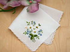 Looking for a sweet little handkerchief? Embroidered at one corner of the handkerchief are daisies and small blue flowers. Daisies symbolize innocence and purity and it's believed in folklore that God sprinkled daisies to cheer people up. Diy Embroidery Patterns, Embroidery Store, Embroidery On Clothes, Flower Embroidery Designs, Custom Embroidery, Hand Embroidery, Handkerchief Embroidery, Handkerchief Crafts, Blue Flowers
