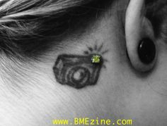Camera tattoo with microdermal rhinestone flash. i kind of like this idea!     But put it on the inside of your rist that would be really cute