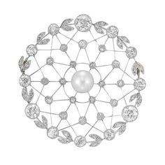 Edwardian Platinum, Pearl and Diamond Pendant-Brooch  The circular openwork brooch highlighting a platinum wire snowflake motif, centering one pearl approximately 6.6 mm., encircled by a diamond-set garland design, set throughout with 12 old-mine and 18 old European-cut diamonds, total approximately 2.20 cts., circa 1910, approximately 8 dwt.