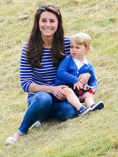 The Duchess of Cambridge and Prince George watching Prince William & Prince Harry play polo at the Beaufort Polo Club, Tetbury, England, June 14, 2015