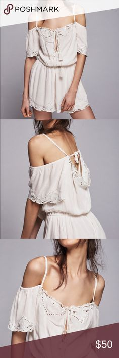 Free People 'Romance' Cold Shoulder Romper XS Excellent condition! This is a RePosh; I have never worn it and the previous owner wore it just once. A shoulder-baring bodice with a daring keyhole adds festival-ready style to a gauzy romper finished with sweet eyelet trim and tassel-tipped ties, of course. Ties behind back. Sweetheart neck with keyhole and tie closure. Short sleeves. Elastic waistband. Lined. 100% rayon. Dry clean or machine wash cold, line dry. By Free People Free People…