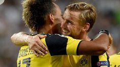 Pierre-Emerick Aubameyang gets a hug from Marcel Schmelzer after rounding off Dortmund's victory in the 87th minute