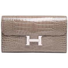 Preowned Hermes Gris Tourterelle Shiny Alligator Constance Clutch... ($16,475) ❤ liked on Polyvore featuring bags, wallets, multiple, hardware bag, clutch wallet, hermes bag, snap closure wallet and lock wallet
