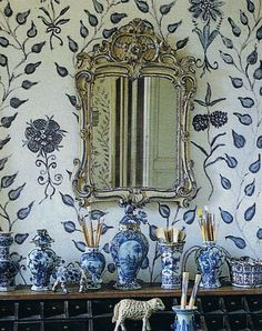 hand painted walls by Lillian Williams \ with a cool antique mirror and blue and white chinoiserie porcelains