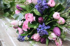 #weddingflower meanings - love this bouquet  - Perfect happiness, confidence & love, Purple Tulip – Royalty, Hyacinth – Sincerity, Ranunculus – Radiance #britishflowers