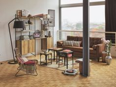 Un mobilier bois/acier pour un salon chaleureux - Un salon au total look industriel