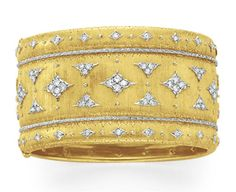 A DIAMOND AND GOLD BANGLE BRACELET, BY BUCCELLATI   The wide hinged 18k gold bangle set with sculpted circular and single-cut diamond motifs, mounted in 18k gold, 2 1/8 ins. diameter, 1 3/8 ins. wide  Signed Buccellati, Italy