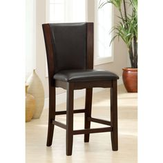 Stay comfortable over coffee and dessert with these counter height chairs. The solid wood frame has a warm and inviting dark cherry finish that gives the chairs a classic elegance and highlights your choice of black or white leatherette upholstery.