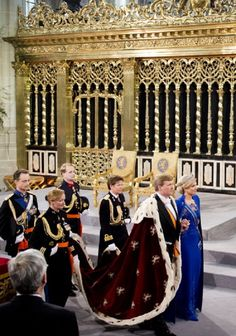 HM King Willem Alexander of the Netherlands leaves with HM Queen Maxima of the Netherlands after their inauguration ceremony at New Church