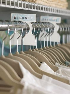 At-Home Boutique: Sliding rod organizers outfitted with labels take a cue from retails displays and take the guesswork out of putting away your clothes. Felt-covered hangers ensure no garments end up crumpled on the floor.