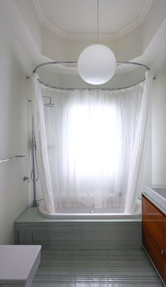 White Shower Curtains for Elegant Look Bath Interior: Wonderful Tub Area With White Tub White Curtain Grey Tile Floor Round Lamp Wood Vanity...