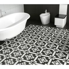 Victorian B&W Mosaic Effect is a black and white pattern matt porcelain floor tile by Codicer Tiles. Use in conjunction with the plain black or white tiles to give your floor a classic pattern effect (as seen in the photo-sold separate). Code MOSAIC 101B These Black or White Floor tiles are ideal for creating a beautiful feel in your Kitchens, Bathrooms on Walls or Floors, Conservatory's, Bedroom, Hallway or Living Room. Sized at 33cm x 33cm The cheapest tiles on the net at Ceramic Planet