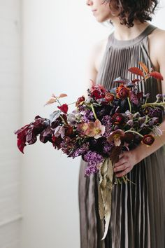 Bouquet made at Sarah Winward workshop, deep, dark purple, red, orange, fall colours, spring colours, hellebore, ranunculus, lilac, fritillaria florist, floral designer, floral design, floral stylist, fine art photography, fine art flowers. Photo by Kate Osborne