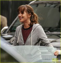 Dakota Johnson is all smiles while filming a scene for one of the upcoming Fifty Shades movies on Tuesday (June 14) in Vancouver, Canada.