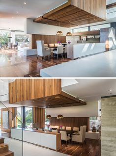 This open dining room has a wooden feature ceiling.