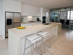 White kitchen, island bench and handle free cupboard ideas