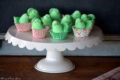 peeps in cupcake papers on cake pedestal