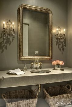 Grey paint, an antique mirror & dual accent sconces make for a beautiful bathroom
