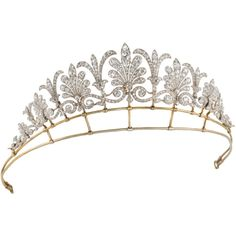 This palmette tiara has approx seven honeysuckle motifs, alternated with fleur de lys spacers and interlinking scrolls at the base
