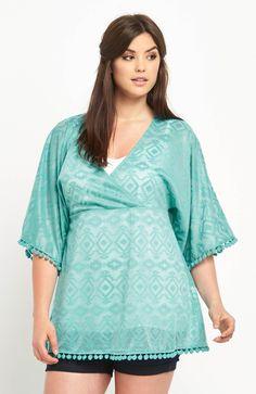 Stylowa sukienka/tunika z cieńszego dżersej marki So Fabulous. Modne, kopertowe wykończenie + szerokie rękawy. Dostępna od roz. 42 do roz.56, 219 zł na http://www.halens.pl/moda-damska-na-gore-kimono-26630/sukienka-577277?imageId=400966&variantId=577277-0011