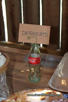 While not a place card holder for individual names, this is a great idea for identifying where foods should go for a potluck!