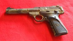 Browning Buckmark Camper .22lr Limited production model with 5.5 inch bull barrel, target sights, and camo finish.