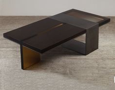 DARK COFFEE TABLE | Strap Desi Coffee Table | Discover more coffee tables ideas: www.bocadolobo.com #moderncoffeetables #luxurycoffeetables