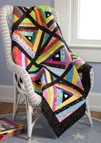 Pixie Sticks is a fun quilt and made by Sally Weber for Quilts for Kids!  Check out the Scrap Quilts issue at http://www.fonsandporter.com or on your local newsstand.