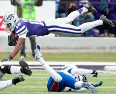 Kansas State's Tyler Lockett is knocked into the air by Kansas' Josh Ford while returning a kick Kansas State Football, Kansas State University, Chiefs Football, Football Ticket, College Football, Tyler Lockett, All Things Purple, Sports News, Volleyball