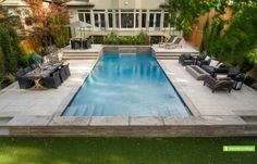 This Toronto couple wanted a good sized pool, patio and lawn area for entertaining friends and family recreation. Since the backyard slopes gently front to back, Betz created a symmetrical design to function on four levels. The focal point is a Gunite pool with the deep end next to the house. You can just walk out and dive in. Next photos are same pool. (16 x 36, rectangular)