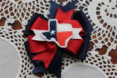 This adorable bow is the perfect bow for any Texas lovin little girl. Show your state pride with this bow and felt center.  Measures 4 across