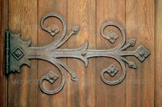 Ornamental hinge ...  ancient, antique, architecture, austere, brown, building, castle, cathedral, church, closed, construction, dark, decorative, detail, door, doorway, entrance, entry, gate, gothic, grunge, hardwood, heavy, hinge, hinged, history, house, iron, metal, nail, obsolete, old, ornamental, plank, retro, rust, rustic, rusty, secure, shut, steel, strong, sturdy, threshold, vintage, weathered, wood, wooden, wrought