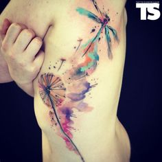 blowing dandelion & dragonfly flower watercolor tattoo on girl's side