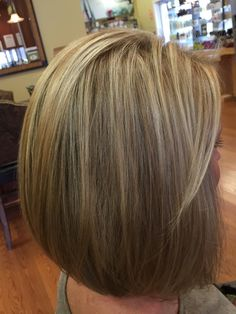 Beautiful blonde with base break and tapered bob