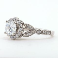 Vintage Floral Style Halo Engagement Ring - Lilly by Moissanite Rings. Shop now at http://www.moissaniterings.com!