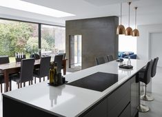 When creating two separate seating areas within an open plan design, it is important that each space is well defined for their respective use - for example, a breakfast bar for casual dining and larger table for entertaining Minimal Kitchen Design, Minimalist Kitchen, Open Plan Kitchen Dining Living, Dining Room, Large Open Plan Kitchens, Seating Areas, New Homes, Contemporary, Modern