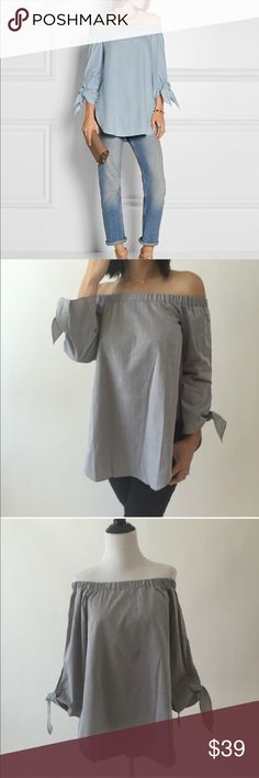 "Grey off shoulder knotted top Material: light cotton. Super chic. Material: light cotton. No sheer. NOTE: if wanting the loose look in the pic, order ONE SIZE UP. Nwot. US s : bust: 35-36 inches, length: 23 inches. US m ) : bust- 36-37 inches, length-24 inches. US L): bust-37-38"", length: 25"". US XL bust-38-39"", length: 25-26"". US XXL): bust-40"", length: 26-27"" Tops Blouses"