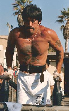 Danny Trejo doing dips at Muscle Beach circa 1980
