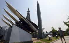 North Korea fires missile in latest provocation   By AFP            A man walks past replicas of a North Korean Scud-B missile (C) and Sou...