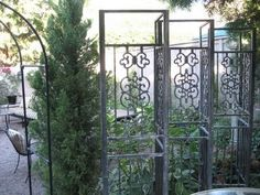 use old gazebo frame | Use old gazebo supports for a screen wall.