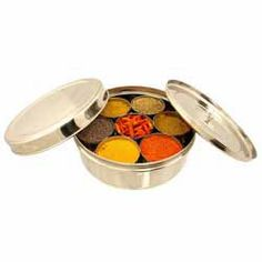 Buy Masala Dabba (Stainless Steel Spice Box) online from Spices of India - The UK's leading Indian Grocer. Free delivery on Masala Dabba (Stainless Steel Spice Box) (conditions apply). 7 Spice, Spice Tins, Top Recipes, Indian Food Recipes, Dog Food Recipes, Indian Spice Box, Lime Pickles, Ground Turmeric, Indian Homes