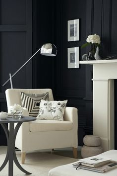 classic style, modern colors: black walls, white and grey furniture