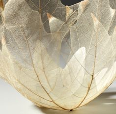 Drape freshly decoupaged leaves over an upside down bowl and let dry. Remove the leaves for the bowl and Voila! Use as a votive holder, shade for string lights or use many for a beautiful fall mobile!