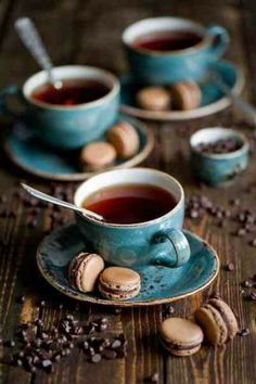 I really like these cups and saucers....wouldn't mind one of those little tasty looking morsels either! ;0)