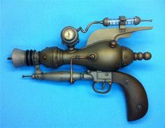 H.O.R.U.S. steampunk laser gun by Resinator Labs. (They sell kits to make your own. Pricey, but gorgeous.)