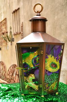 Bevolo Rault Pool House Lantern filled with Beads, Mask and other Mardi Gras throws. #bevolo #lanterns
